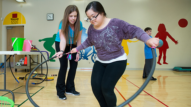 Victoria Espinal gets some help on her jump rope skills from Kathryn Cerasuolo at the Motor Development Clinic at Cal Poly Pomona.