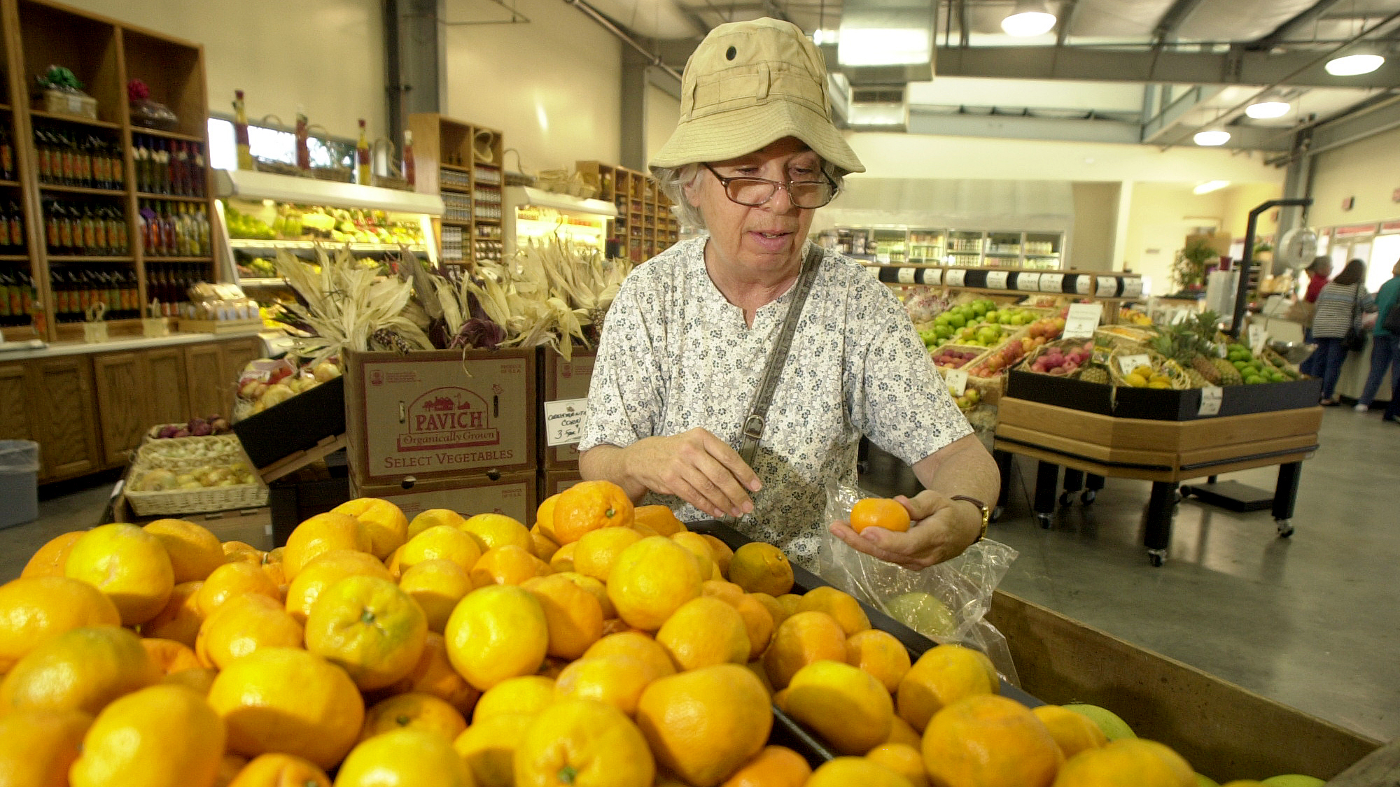 Karen Harvey looks over Satsuma Mandarin Oranges for sale at the Farm Store at Kellogg Ranch.