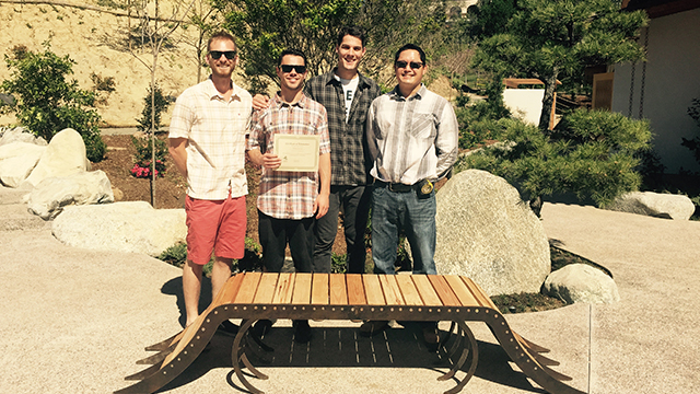 Landscape architecture students show off one of their winning bench designs for a Japanese Friendship Garden in San Diego's Balboa Park.