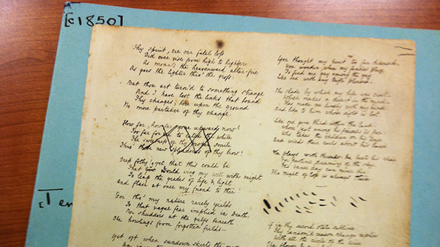 """Graduate English students recently visited the Huntington Library to see rare texts, including this folio of Alfred Lord Tennyson's """"In Memoriam"""" in his own handwriting."""