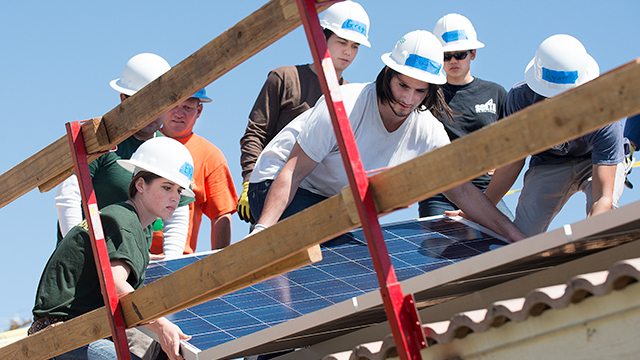 Engineering students help install solar grid systems at houses in Desert Hot Springs during their Spring Break.