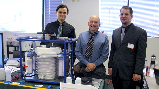 Student Ion Darmancev, Professor Dixon Davis and student Eric Cramer pose with their prize-winning water purification system. The students recently won Grand Prize and Best of Show at the Product and Manufacturing Systems Design Contest Challenge.