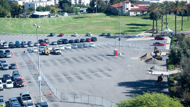 Fences cordon off a portion of parking lot C.