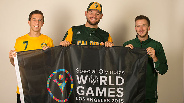 Kris Korich, Max Bethell and Rodger Mantor with the Special Olympics banner.