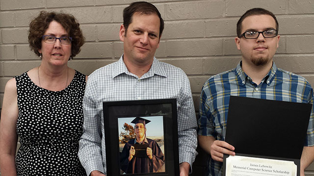 Susan and Paul Lebowitz, holding a photo of their son, James, with scholarship recipient Thomas Sedlak.