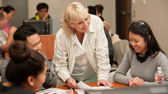 """Professor Rhonda Rhodes, who co-authored """"Report Writing: A Survival Guide"""" with Professor Emeritus Joyce Kupsh, talks to students."""