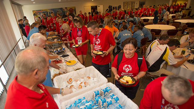 The team from Poland gets breakfast during a pancake breakfast for teams competing in the Special Olympics World Games.