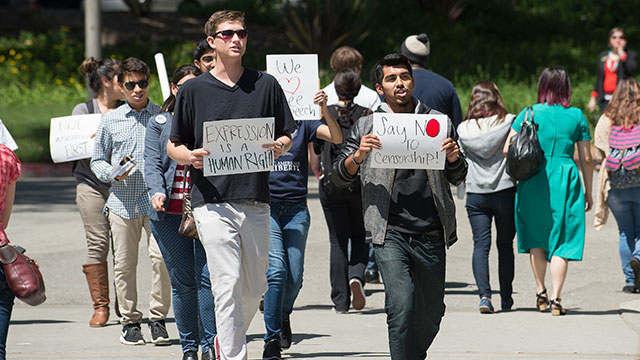 Cal Poly Pomona students march in a free speech rally on campus on April 9, 2015.