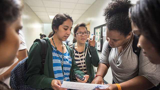 Freshman engineering students consult a map as they plan the route to their next class on the first day of classes at Cal Poly Pomona.