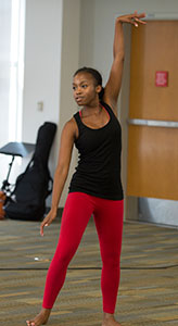 """Saundra Ridgle performs her dance """"Concurrent,"""" during the Creative Activities and Research Symposium at the University Library at Cal Poly Pomona August 19, 2015."""