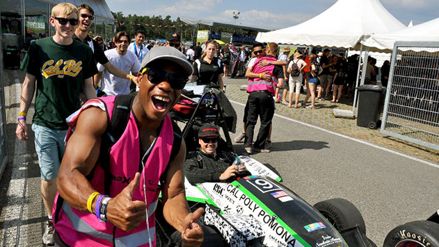 Cal Poly Pomona's Formula SAE racing team celebrates after a win in Germany.