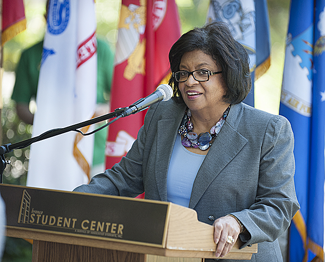 President Soraya Coley speaks at mixer for Veterans in the Japanese Garden at Cal Poly Pomona.