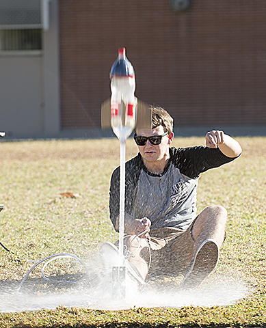 Wayne Page launches a water bottle rocket in the Bronco Commons for his Aero 103 class at Cal Poly Pomona.