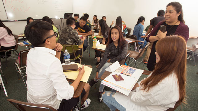 Students from China work on their English skills as part of a new aviation hospitality program on campus.