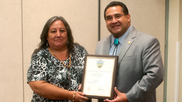 Lorene Sisquoc, a visiting Native American scholar, (left) accepts a certificate of recognition from the San Bernardino County Board of Supervisors.