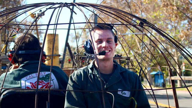 Students ride  the partially-finished Cal Poly University's rose float during a safety inspection. (Photo courtesy of Brent Hollinger)