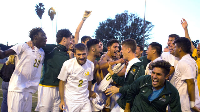 The men's soccer team celebrates after their win over Stanislaus State. The win is taking them to the NCAA playoffs.