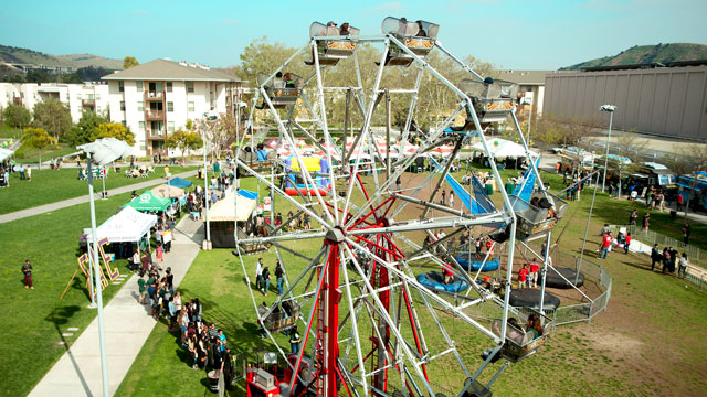A Ferris wheel dominates the skyline at the Homecoming event.