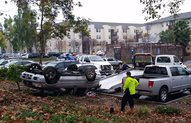 A car flipped onto its roof near the Residential Suites after the driver lost control during wet weather.