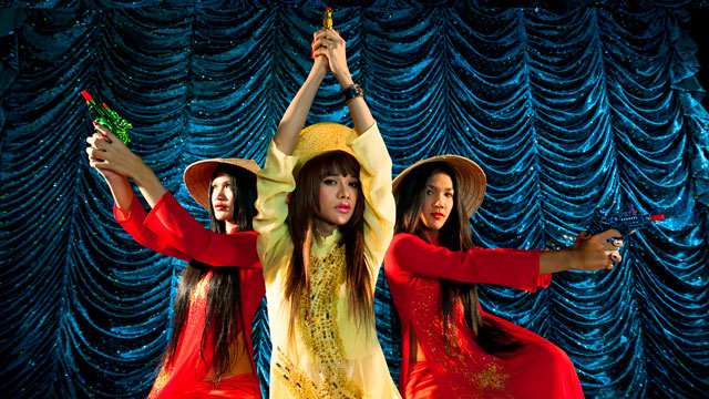 """Charlie's Angels from the """"lovebang!"""" Series, 2014 . The piece is a music video still from the projected video installation that runs at 5 minutes, 31 seconds. Courtesy of the artist Việt Lệ."""