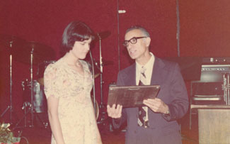Professor Ramiro Dutra, the first chair of the Department of Foods & Nutrition, hands out an outstanding student award to Linda Costa in 1976.