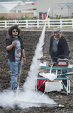 Oddie Byers and David Yaralian launch model rockets during Aero 102 lab at Agriscapes at Cal Poly Pomona.