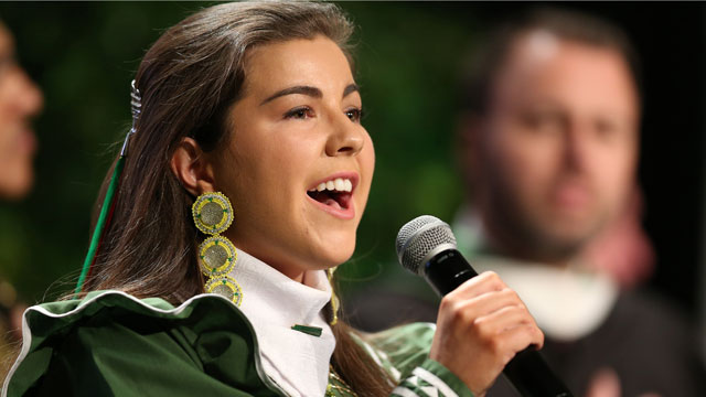 Sarah De Herrera, who is studying business administration, sang the national anthem in her native Choctaw tribal language at the Investiture ceremony for President Soraya M. Coley.