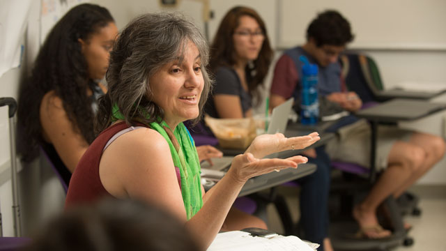 """Professor Rosanne Welch discusses the concept of """"othering"""" with her students."""