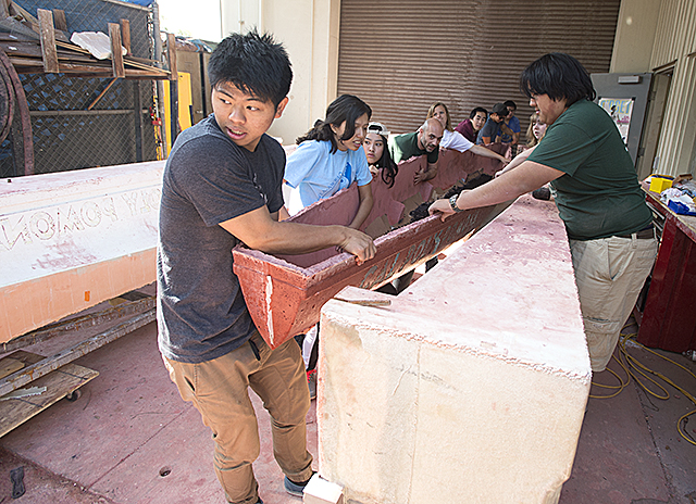 The 2016 concrete canoe,  Manaia, is removed from its mold for the first time at Cal Poly Pomona.