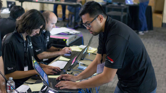 Jose Ybanez monitors network traffic during Cal Poly Pomona's first place finish at the Western Regional Collegiate Cyber Defense Competition on March 18-19 at Fairplex.