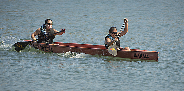Engineering students Lori Ishigo and Serena Hinojosa compete in the women's endurance competition at the Pacific Southwest Concrete Canoe Competition in Long Beach.