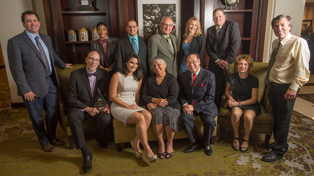 The recipients of the Distinguished Alumni Awards for 2016 are (front row from left) Kirk Jones, Roy Conli, Bailee Rad, Sue Godfrey, Raymond K. Cheng, and Dina Perry and Damon Goldstein accepting the award on behalf of Chevy Axelrad Goldstein; and (back row from left) Violet Palmer, Sep Eskandari (Alumni Outstanding Teaching Award winner), Tony Godfrey, Leanne Swanson and Lance Williams.