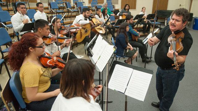"Jesús ""Chuy"" Guzmán, Grammy Award-winning musical director of Mariachi Los Camperos De Nati Cano, gives a master class to mariachi ensemble students."