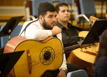 Students listen intently during a mariachi master class.