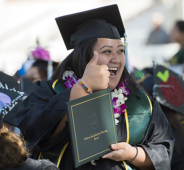 It's thumbs up for a graduate at The College of Education and Integrative Studies commencement ceremony at Cal Poly Pomona.