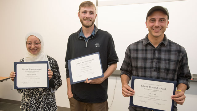 Seniors Malak Habbak, Jeffrey Nelson and Ian Joyce are the winners of the inaugural Library Research Contest.