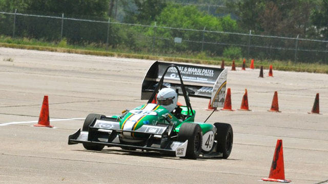 Cal Poly Pomona's Formula SAE car races around a track in Lincoln, Nebraska.