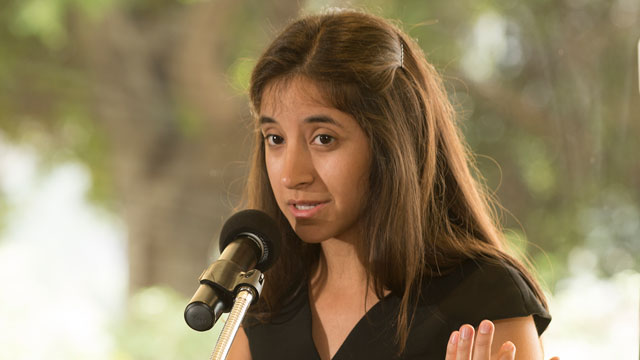 Vivianne Mitri, a second-year business student and founder of the Cal Poly Pomona Alzheimer's Buddy Program, accepts a Center for Community Engagement Reach Beyond Award during a ceremony in May.