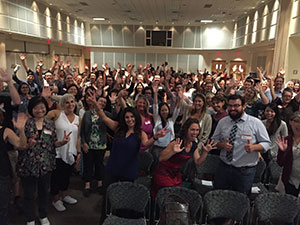 """Teachers and administrators pose for an Instagram photo at the """"Better Together: California Teachers Summit 2016"""" at Cal Poly Pomona."""