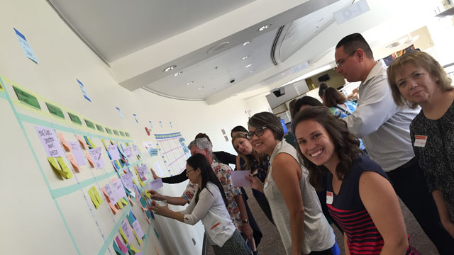 "Edcamp facilitators build and organize a session board before breakout discussions begin at the ""Better Together: California Teachers Summit 2016"" at Cal Poly Pomona."