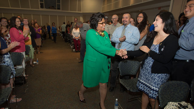 President Soraya M. Coley greets staff members during the 2016 Fall Conference kick off.