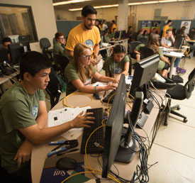 Campers work on a project during GenCyber Camp for high school students that introduces the fundamentals of operation systems, forensics and networking concepts.