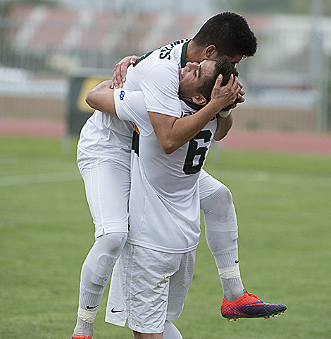 Jesus Tamayo hugs Jose Garcia after Garcia scored the first goal of the game during the Broncos game against Cal State San Marcos.