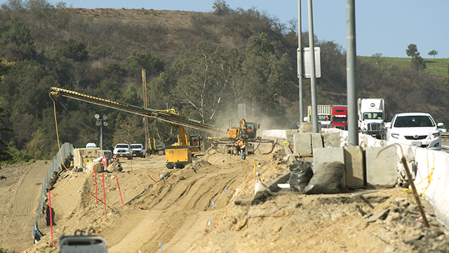 Caltrans crews work to widen the 10 Freeway north of campus.