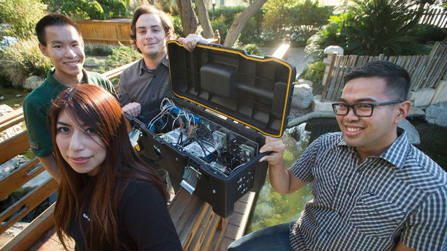 Cal Poly Pomona students Raissa Englehard, clockwise from bottom, Nate Hom, Joe Needleman and Jose Ybanez built a device that replicated the functions of a water-treatment plant for the Passcode Cup cybersecurity competition.