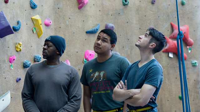 """K2"" director Michael T. Kachingwe (left) observes the rock wall at the Bronco Recreation and Intramural Complex with actors Andrew Garcia (middle) and Tristan Price."