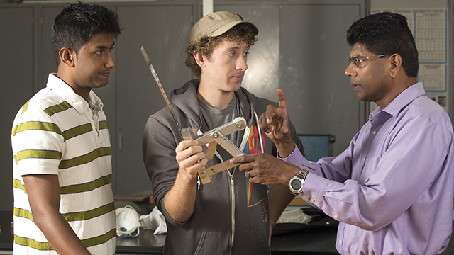 Mariappan Jawaharlal (right), also known as Jawa, discusses biomimicry research with two students.