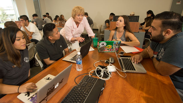 Professor Rhonda Rhodes, who is a faculty donor, explains a concept to students in her class at the College of Business Administration.
