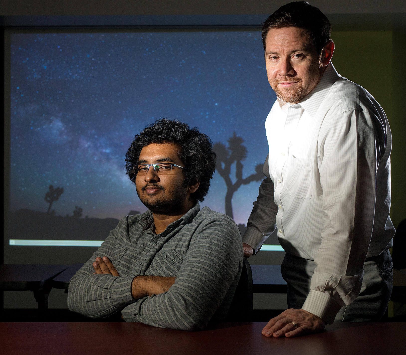 Student researcher Tharindu Jayasinghe, left, and Professor Matthew Povich of the physics and astronomy department lead the Milky Way Project based at Cal Poly Pomona.