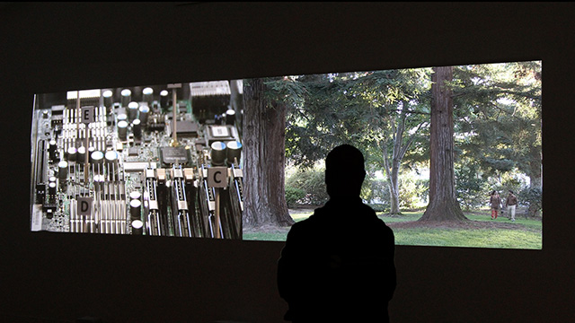 """Somewhere in Between: Silicon Valley"" (installation view), 2012 Two-screen video installation with sound, TRT 18 min. Courtesy of the artist"